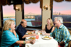 Happy couples enjoying dinner cruise aboard the Creole Queen